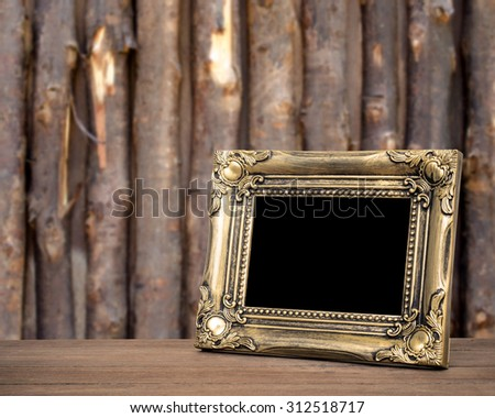 Old picture frame put on wood background. Sepia tone. - stock photo