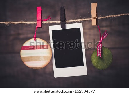Old pictures on wood background with Christmas decoration - stock photo