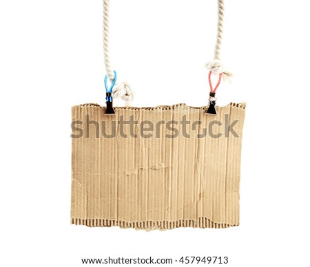 old piece of cardboard on rope - stock photo