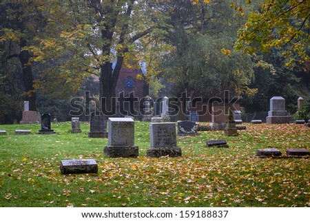 Old Pioneer Cemetery and headstones in fog - stock photo
