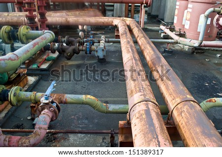 old pipe and valve for water on building - stock photo