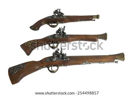 Old pistol isolated on white background - stock photo