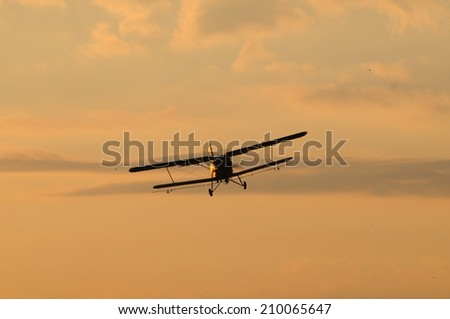 old plane at sunset/old plane at sunset - stock photo