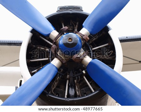 old plane engine with propeller - stock photo
