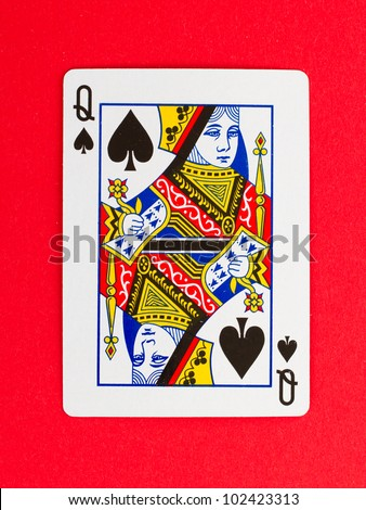 Old playing card (queen) isolated on a red background - stock photo