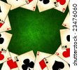 old playing cards on a green background - stock photo
