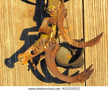 old plow head and a bell - stock photo