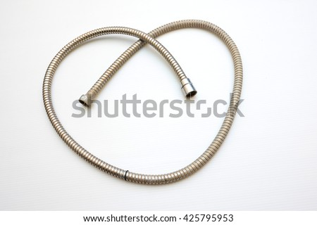 Old plumbing hose pipes - Heart Symbol - stock photo