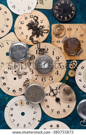 old pocket watch and face old clock, vintage background - stock photo