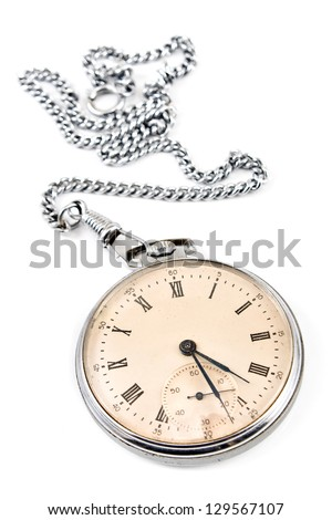 Old pocket watch with chain isolated on white - stock photo