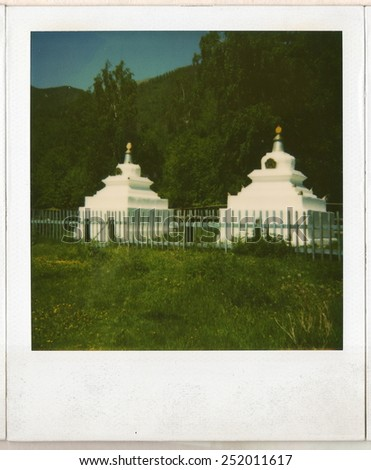 Old Polaroid photo of Buddhist stupa in the Buddhist temple. - stock photo