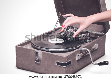 Old portable gramophone with female hand pin-up styled isolated, on white background with empty space - stock photo