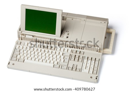 Old portable personal computer, isolated on white background - stock photo