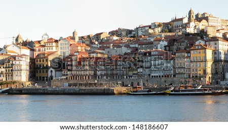 Old Porto at sunrise seeing beautiful Ribeira, churches and typical houses, full of color and life - stock photo