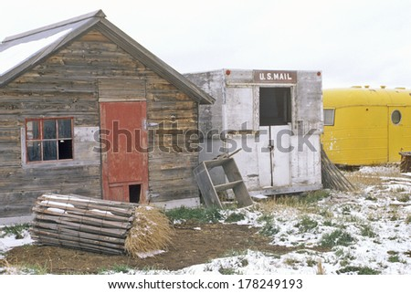 Old post office and cabin in snow - stock photo