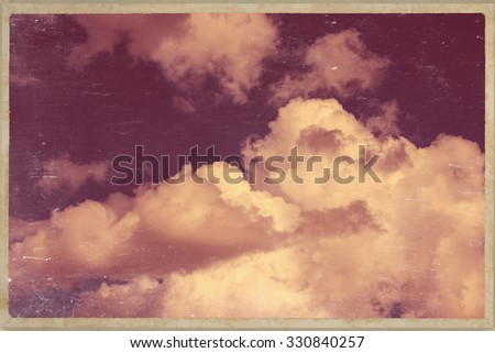 old postcard white clouds against the dark sky - stock photo