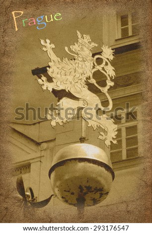 Old postcard with view of Prague gold lion street decor - stock photo