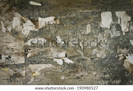 Old poster reminance on grungy old wall - stock photo