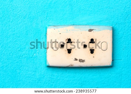 Old power outlet on green background - stock photo