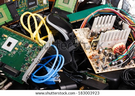Old power supply, cables, hard drive in trash.  - stock photo