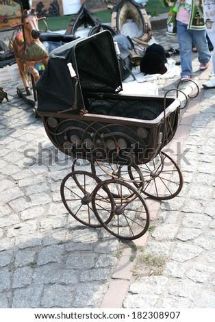 Old pram in flea market in Poland, Gdansk. - stock photo