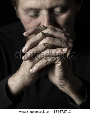 old praying woman - stock photo