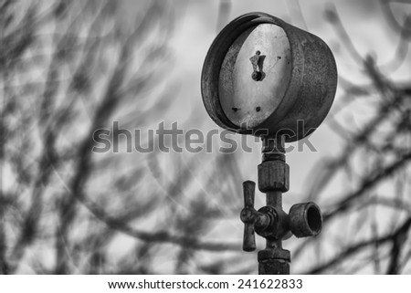 Old pressure gauge monochrome and bough background - stock photo