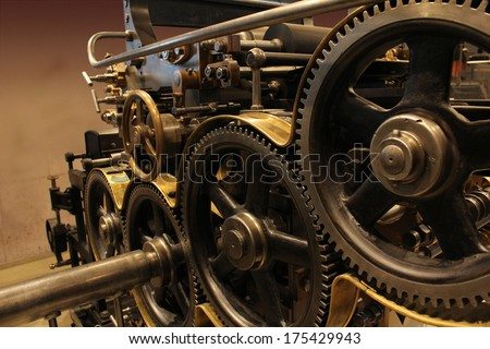 Old printing press, rotary press - stock photo