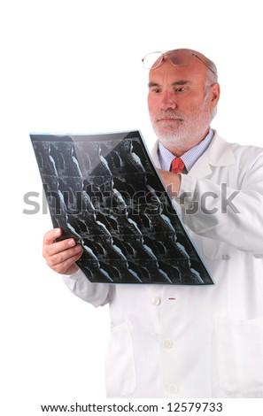 Old professor examine x-ray image in hospital - stock photo