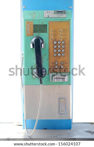 Old public telephone coin in Thailand - stock photo