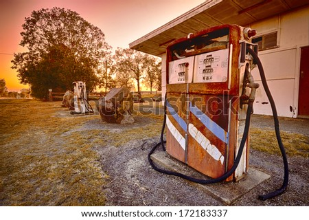 Old pump in fuel station - stock photo