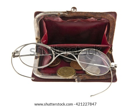 old purse with a money and old glasses isolated on a white background - stock photo