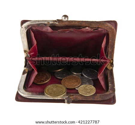 old purse with a money isolated on a white background - stock photo