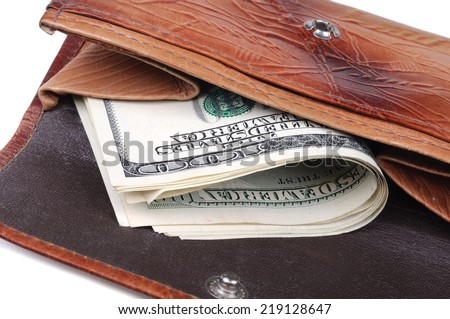 Old purse with banknotes of hundred dollars inside. Closeup with shallow DOF. Isolated on white background. - stock photo