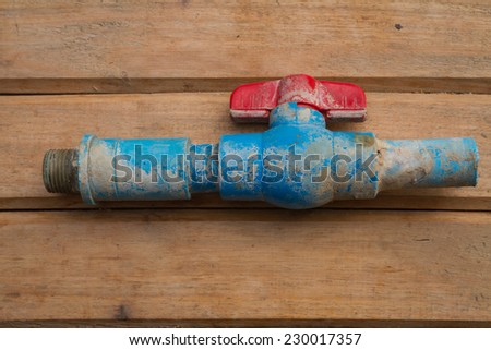 old pvc pipe line system with ball valve - stock photo