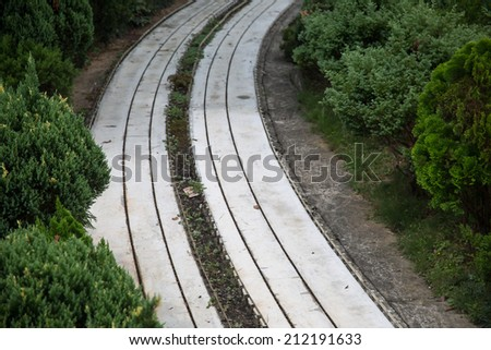 Old railroad tracks scenery/Model and real - stock photo