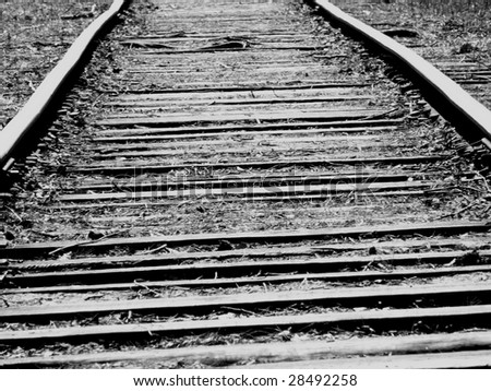 old railway and wooden sleepers - stock photo