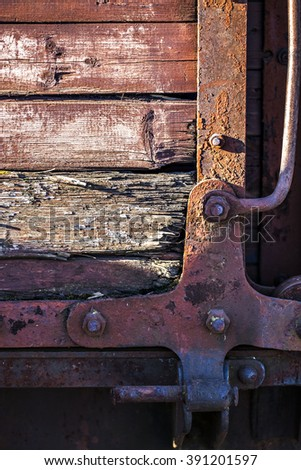 old railway carriage, narrow-gauge railway, rail, bolt locked, wooden board, screws, boxcar, iron forging, rails - stock photo