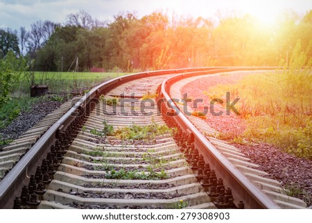 Old Railway in countryside. Scene of railroad in beams of sunset.  - stock photo
