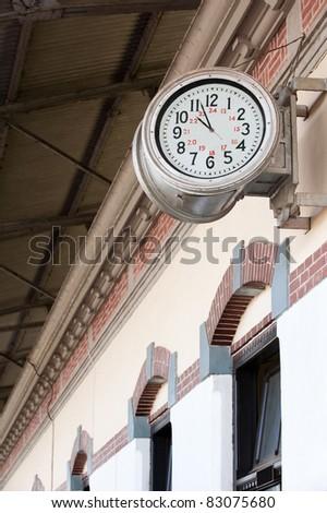 old railway station-clock on a platform - stock photo
