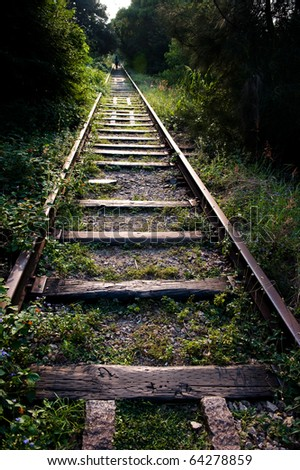 Old railway track in the forest, China. - stock photo