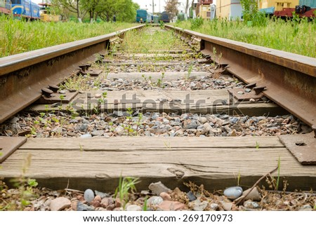 Old railway track with old trains - stock photo