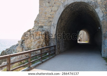 old railway tunnel used now in a promenade - stock photo
