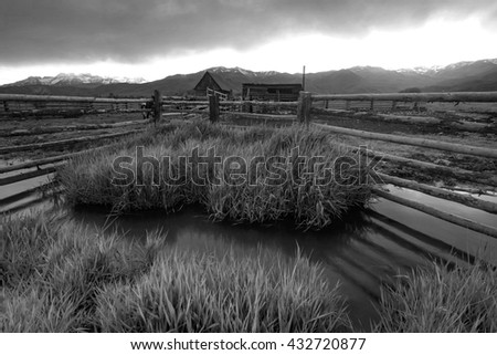 Old ranch fence and sheds in rural Utah, USA. - stock photo