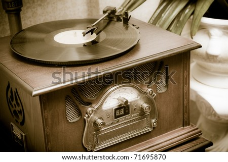 Old record player in the room - stock photo