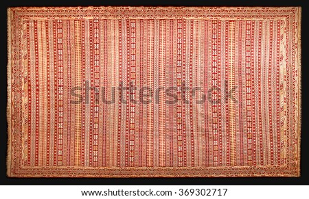 Old rectangular traditional national Iranian or Persian carpet with pattern. top view - stock photo
