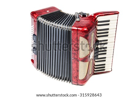 Old red accordion isolated ona  white background - stock photo