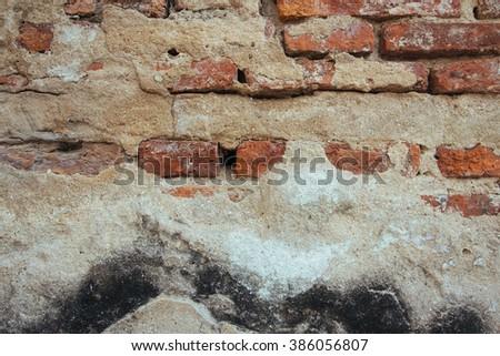 Old red aged brick walls background. History walls in Bangkok - stock photo