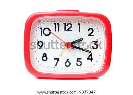 Old red alarm clock on a white background - stock photo