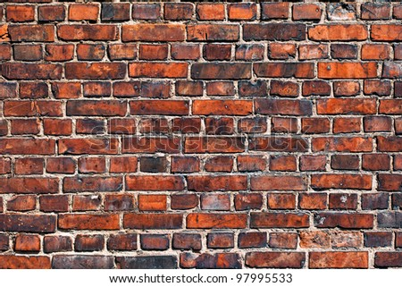 Old red brick wall as background - stock photo